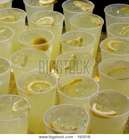 Cups Of Lemonade On Yellow Gingham Tablecloth