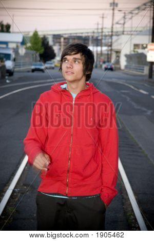 Teen Boy In Red Sweatshirt At Twilight
