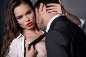Young Passionate Couple Kissing And Hugging In Erotic Scene poster