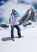 Climber Breathing With Mini Portable Oxygen To Avoid And Treat Altitude Sickness poster
