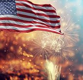 Celebrating Independence Day. United States of America USA flag with fireworks background for 4th of poster