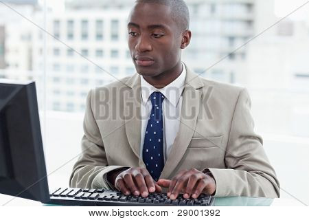 Office worker using a computer in his office