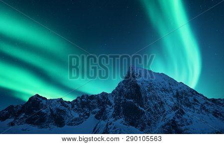 Aurora Borealis Above The Snow