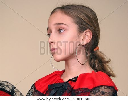 Portrait of a girl with spanish earrings and red dress with black lace