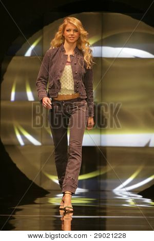 Fashion model walking down the runway