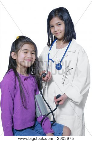 Two Girls Playing Doctor And Patient