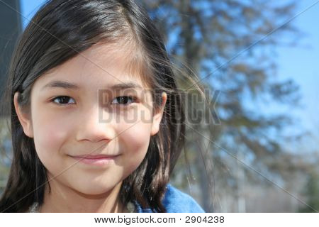 Child Outdoors Smiling