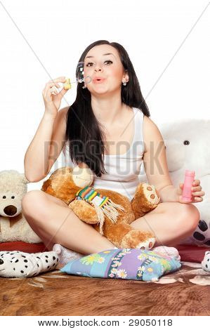 Playful Pretty Girl Blow Bubbles. Isolated