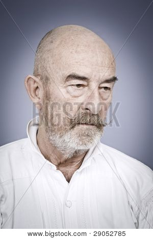 An old man with a grey beard is hopeless