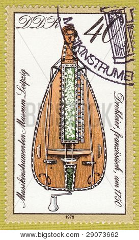 GDR - CIRCA 1979:A stamp printed in East Germany showing the image of musical instrument