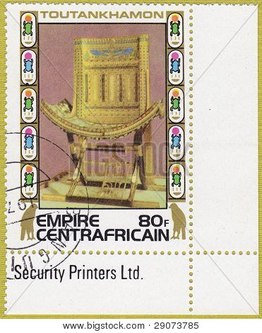 CENTRAFRICAIN - CIRCA 1978: A stamp printed in The Central African Empire showing the image of a throne, series is devoted to Egyptian Pharaoh Tutankhamun, circa 1978