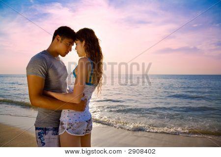 Loving Couple On A Beautiful Sunset Beach