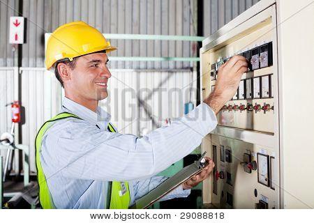 industrial machine operator adjusting machine settings