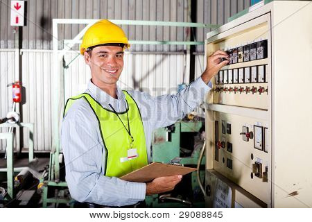 male caucasian technician seeting up industrial machine