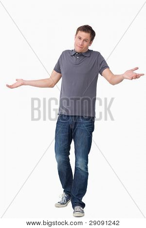 Clueless young man against a white background