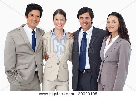 Smiling salespeople standing together against a white background