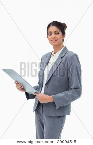 Saleswoman holding clipboard against a white background