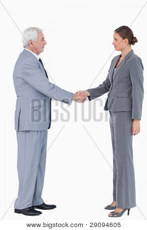 Side view of businesspartner shaking hands against a white background