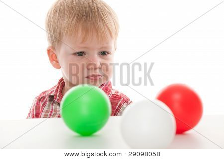 Confused Kid Looking At Balls