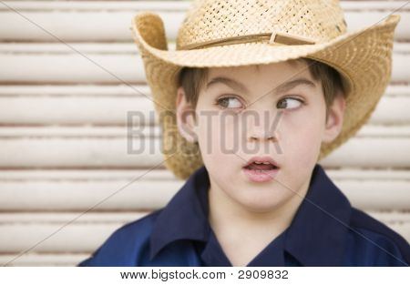 Boy Wearing A Cowboy Hat Looks Left