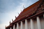 Fine-art Roof Top Of Main Chapel At Wat Kalayanamitr Temple On Cloudy Blue Background poster