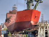 foto of shipbuilding  - Ship during construction works in a shipyard on a shipway - JPG