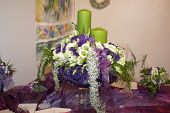 stock photo of flower arrangement  - Flower arrangement with two green candles - JPG