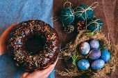 Woman Holding Chocolate Cake With Powder Next To Space Galactic Easter Eggs In Nest Next To Bump And poster
