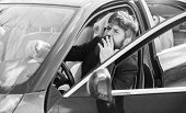 Smoking Bans In Private Vehicles. Man Bearded Businessman Smoking Cigarette While Sit In Car. Driver poster
