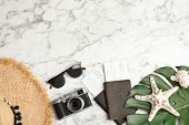 Flat Lay Composition With Tourist Items And Camera On Marble Background, Space For Text. Travel Agen poster