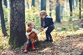 Little Boy And Girl Friends Camping In Woods. Children Play In Autumn Forest. Childhood And Child Fr poster