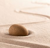 Yoga or zen Buddhism stone and sand background. Concentration or focus point for spiritual balance a poster