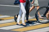 Pedestrians Crossing The Road At A Pedestrian Crossing On Summer Sunny Day poster