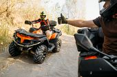 ATV rider showing thumbs up to his partner  poster