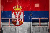 Close-up Of Old Warehouse Gate With National Flag Of Serbia. Concept Of Serbia Export-import, Storag poster