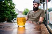 Refreshing With Crisp Finish. Chilled Beer Mug On Cafe Table. Brutal Man Relaxing With Alcoholic Dri poster