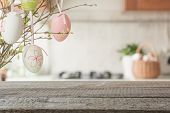 Easter. Blurred Kitchen And Wooden Tabletop With Space For Display Your Product. poster