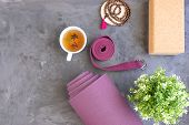 Rolled Yoga Mat With Mala Beads And Ayurveda Tea For Relax Yoga Practice Y Meditation. poster