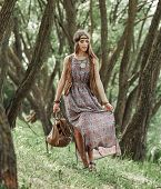 Beautiful Young Hippie Woman Standing Among The Trees In The Park poster