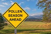 Pollen Season Ahead Caution Sign With Springtime Background poster