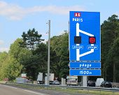 French Motorway And Indications To  Paris In France. The French Text Peage Means Toll Payment In Fre poster