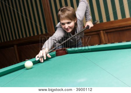Woman Strikes Billiard Ball