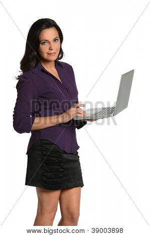 Beautiful businesswoman holding laptop isolated over white background