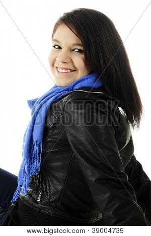 Closeup image of an attractive young teen happily looking over her shoulder.  She's wearing a dark leather jacket and blue neck scarf .  On a white background.