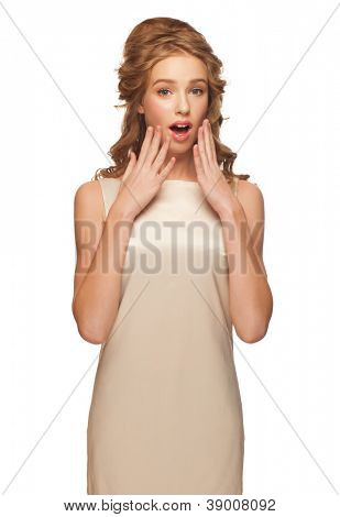 Portrait of attractive young woman touching her face in astonishment  and looking surprised. Isolated on white background