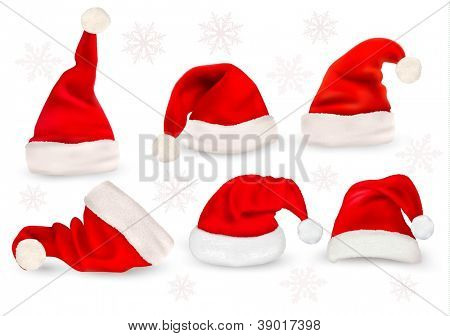 Big collection of red santa hats. Vector.