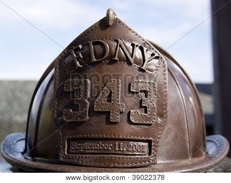 W. ORANGE, NJ-SEPT 11: A bronze sculpture of a firefighters helmet in the 911 memorial inside Eagle Rock Reservation honors victims of the 2001 terror attacks on September 11, 2012 in West Orange, NJ.