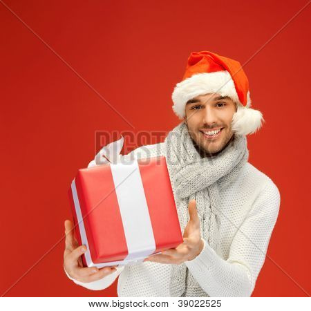 bright picture of handsome man in christmas hat.