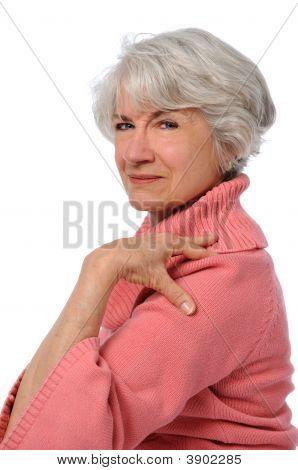 Senior Woman Touching Shoulder