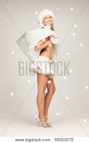 picture of cheerful santa helper girl with big bag.